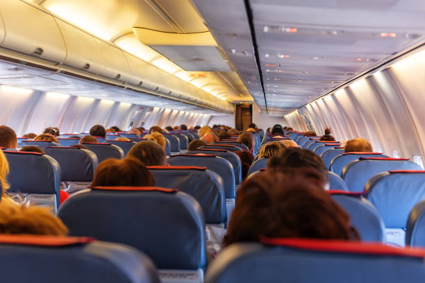 Interior of airplane Interior of airplane with passengers on seats waiting to taik off cabin crew stock pictures, royalty-free photos & images