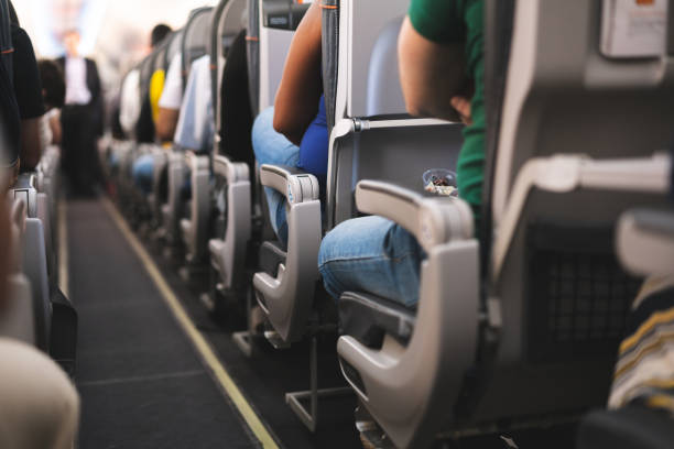 Interior of airplane with passengers on seats Air Vehicle, Airplane, Commercial Airplane, Luggage, People passenger cabin stock pictures, royalty-free photos & images