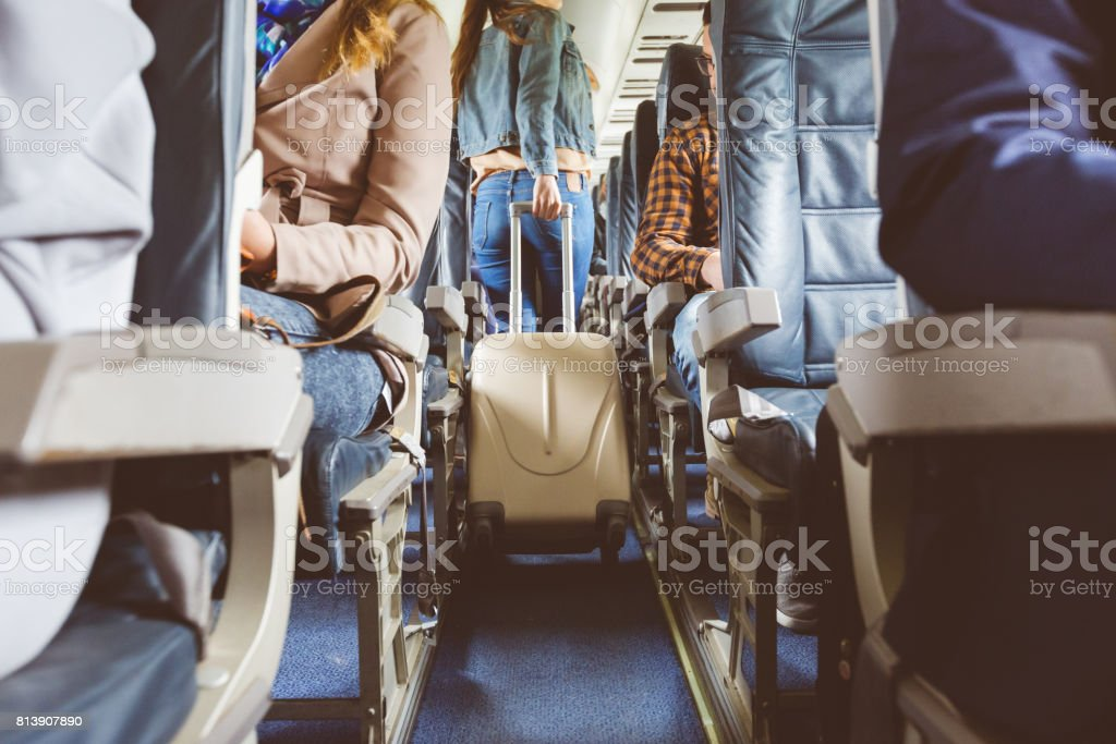 Interior of airplane with people sitting on seats stock photo