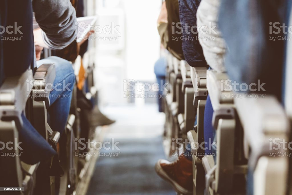 Interior of airplane with people travelling stock photo