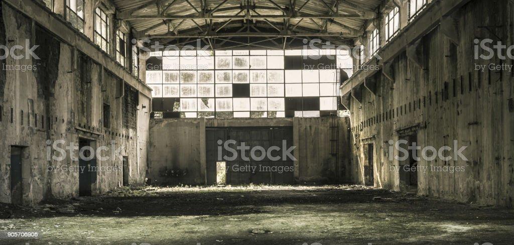 Interior of an abandoned production hall in Tarnita,  Romania. stock photo