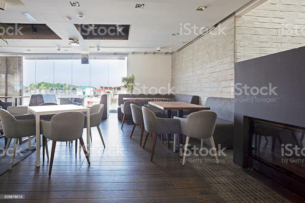 Interior of an elegant riverside cafe stock photo