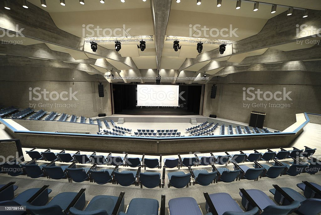 Interior of an empty conference hall from a seat in the back stock photo