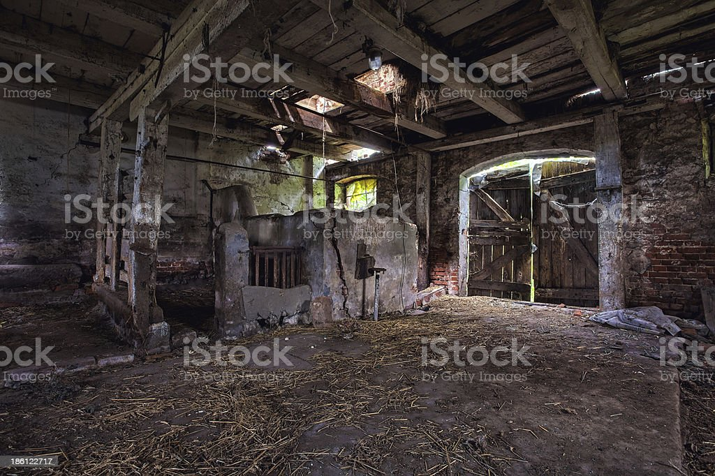 Interior of an old, decaying barn. stock photo
