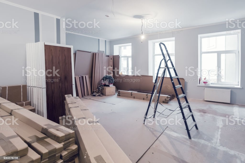 Interior of apartment  during construction, remodeling, renovation, extension, restoration and reconstruction - ladder and construction materials in the room Interior of apartment  during construction, remodeling, renovation, extension, restoration and reconstruction - ladder and construction materials in the room. Apartment Stock Photo