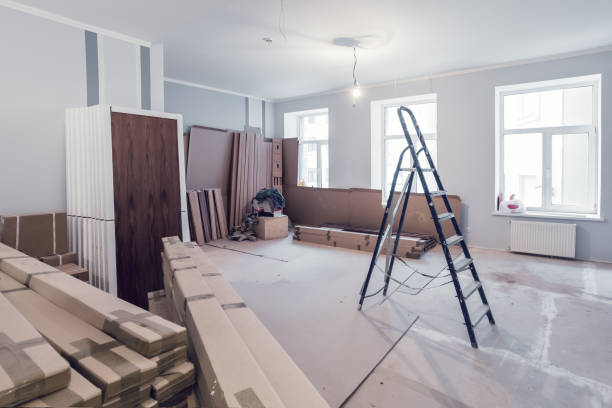 Interior of apartment  during construction, remodeling, renovation, extension, restoration and reconstruction - ladder and construction materials in the room stock photo