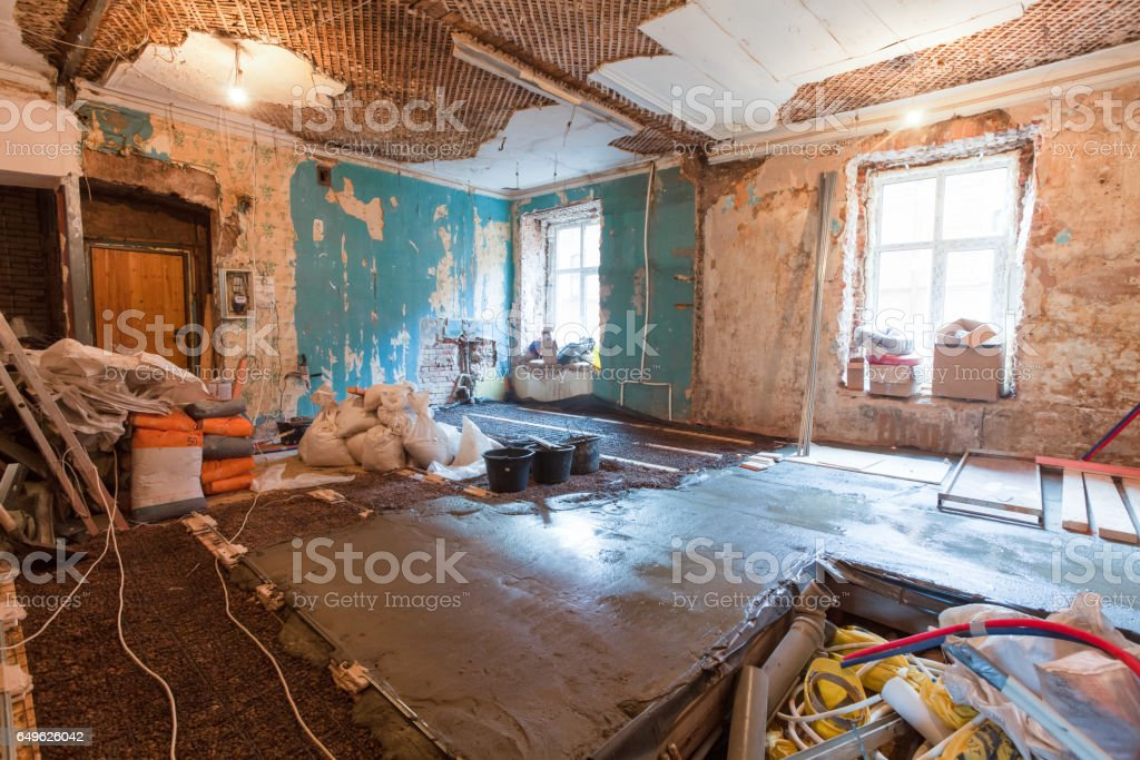 Interior of apartment with materials during on the renovation and construction ( making wall from gypsum plasterboard) stock photo