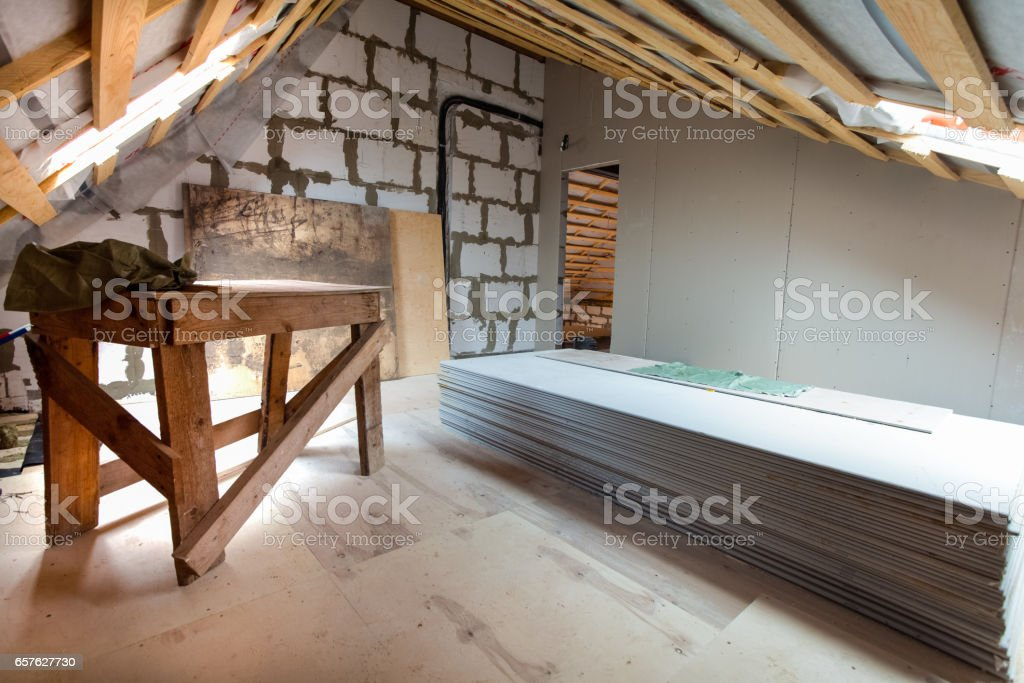 Interior of apartment with materials during under renovation, remodeling and construction. (preparing to build walls from gypsum plasterboard) stock photo