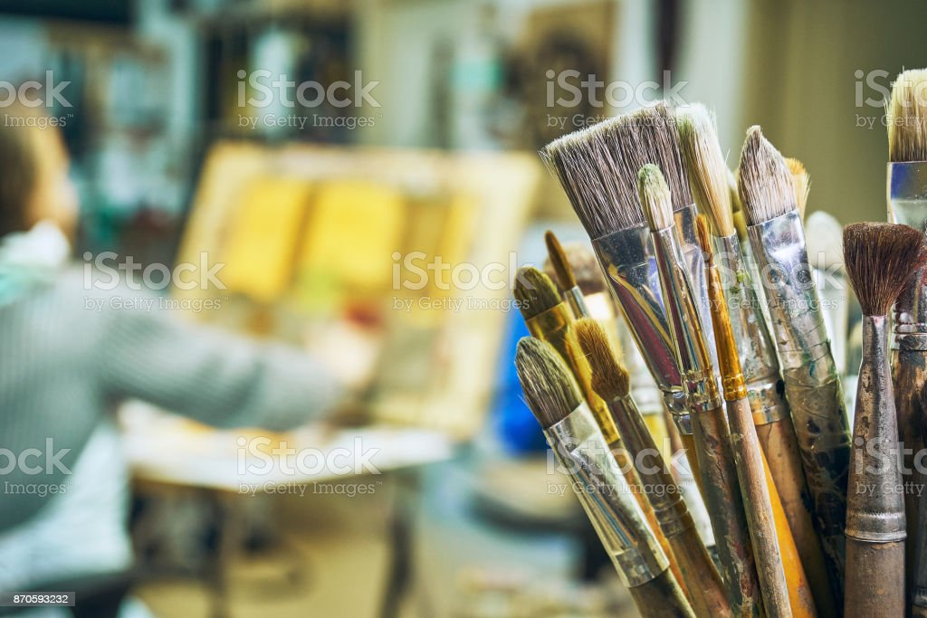 Interior of art studio with girl that drawing a picture stock photo