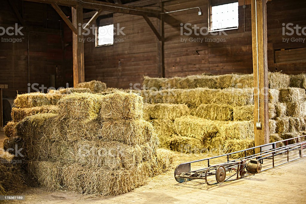 Interior of barn with hay bales stock photo