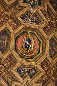 Rome, Italy - June 13, 2015: Interior of Basilica di Santa Maria in Trastevere in Rome. Italy.  Octagonal ceiling painting Assumption of the Virgin by Domenichino
