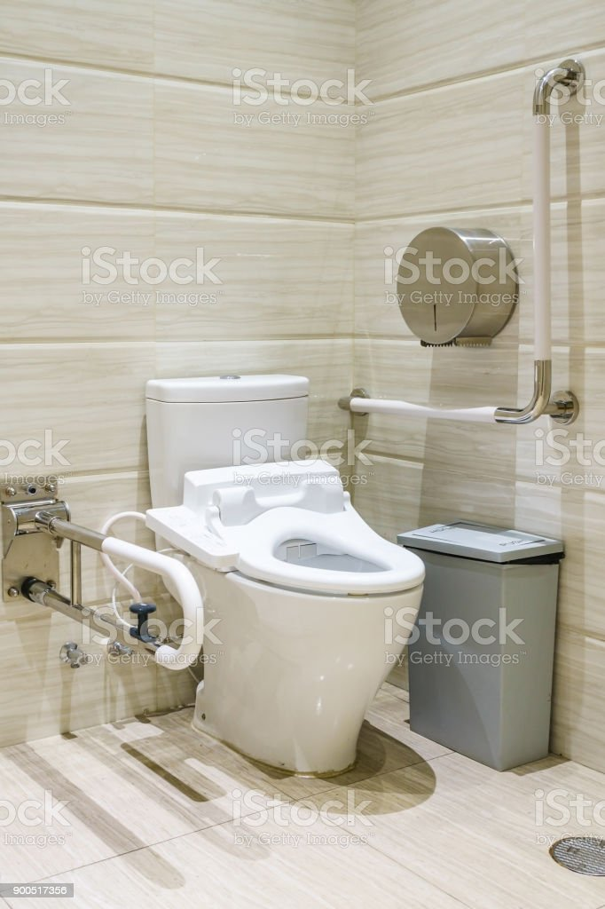 Interior of bathroom for the disabled or elderly people. Handrail for disabled and elderly people in the bathroom stock photo