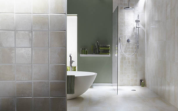 interior of bathroom in cool green with a running shower - tile stock photos and pictures