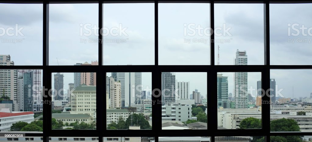 Interior of buildings view of city from the office windows.