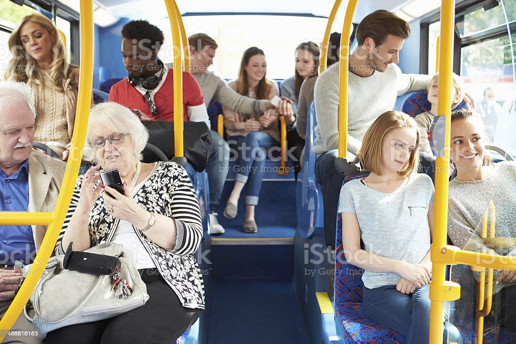 Interior Of Bus With Passengers Interior Of Bus With Passengers During The Day 20-29 Years Stock Photo