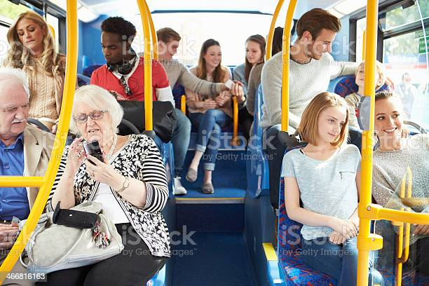Interior Of Bus With Passengers Stock Photo - Download Image Now