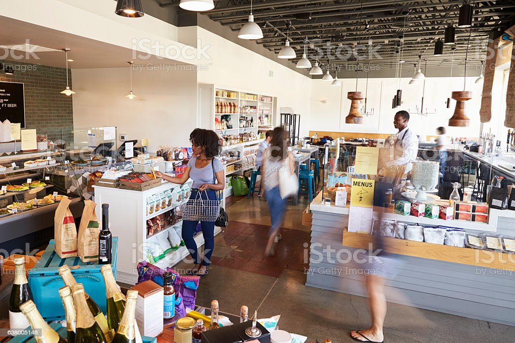 Interior Of Busy Delicatessen With Customers foto