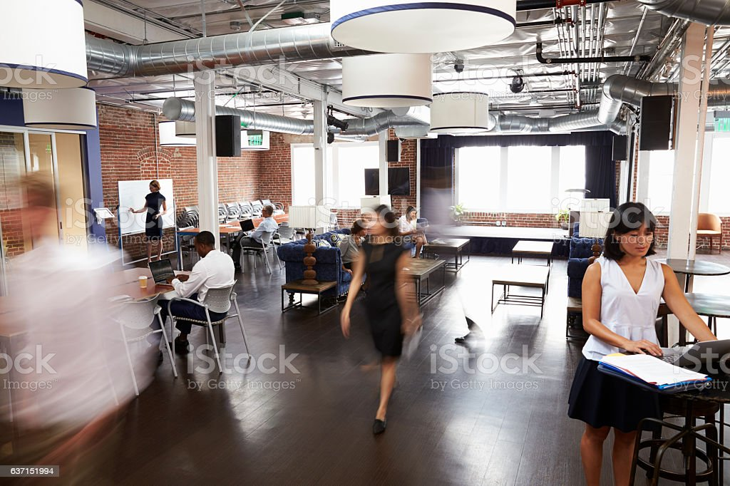 Interior Of Busy Design Office With Staff - foto de stock
