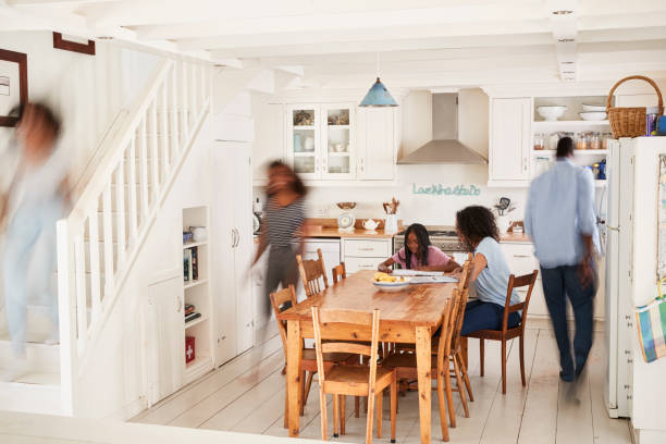 interior of busy family home with blurred figures - busy stock photos and pictures