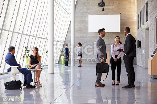 istock Interior Of Busy Office Foyer Area With Businesspeople 504879112