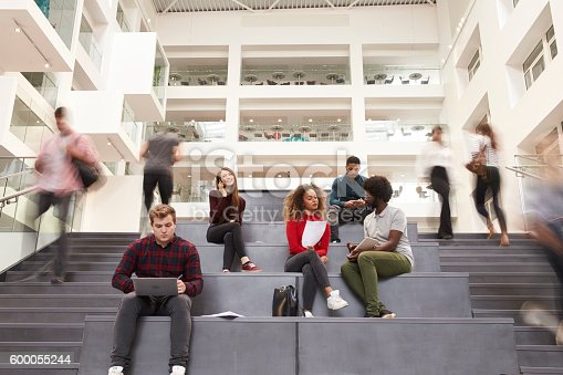 istock Interior Of Busy University Campus Building With Students 600055244