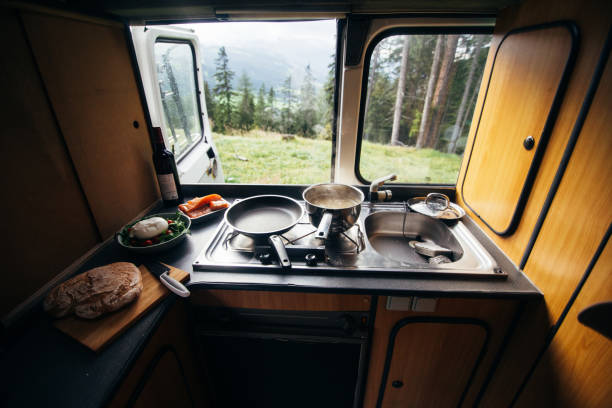 Interior of camper van with kitchen and view stock photo