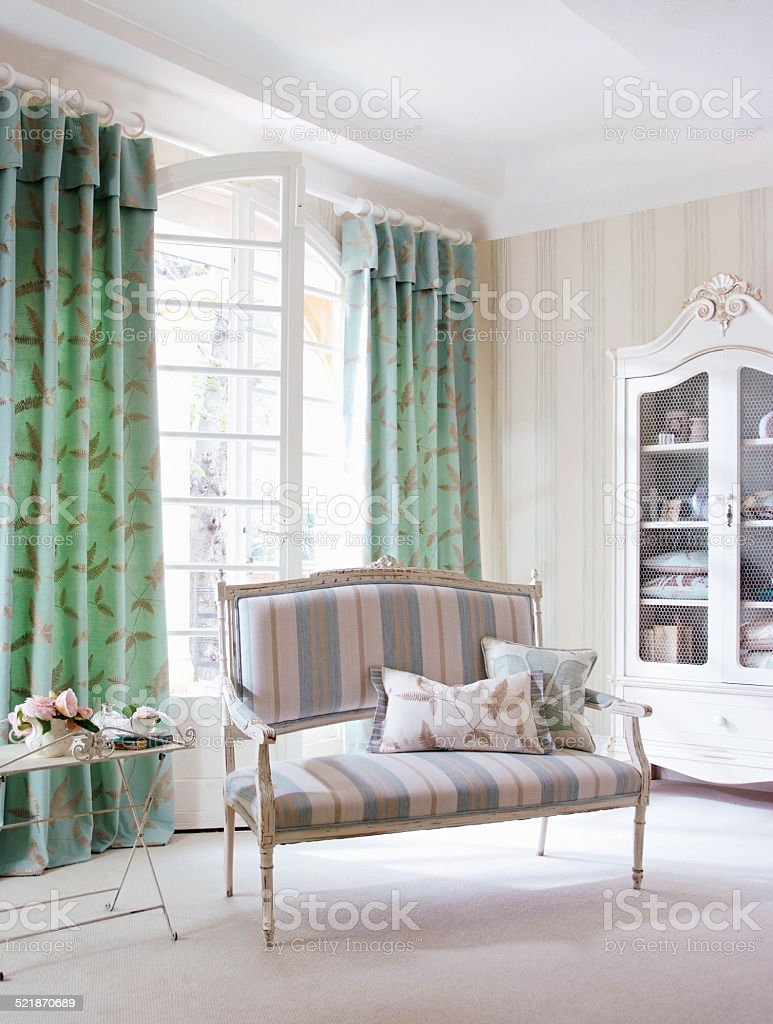 Interior of chair and french dresser in living area stock photo