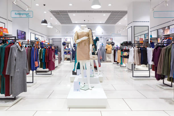 Interior of clothing store. Interior of fashion clothing store for women. garment stock pictures, royalty-free photos & images