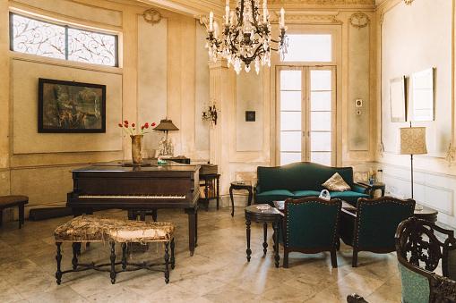 Interior of abandoned ornate living room in Colonial Villa in Havana