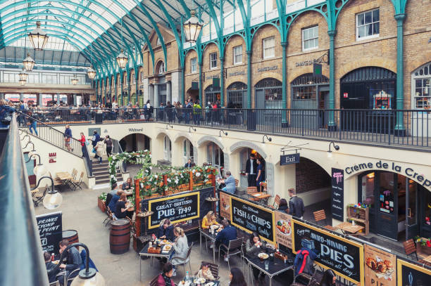 Interior of Covent Garden Market, a place for fashionable retail stores and dining on popular tourist site surrounded by historical buildings, theatres and entertainment facilities in Westminster City, Greater London stock photo