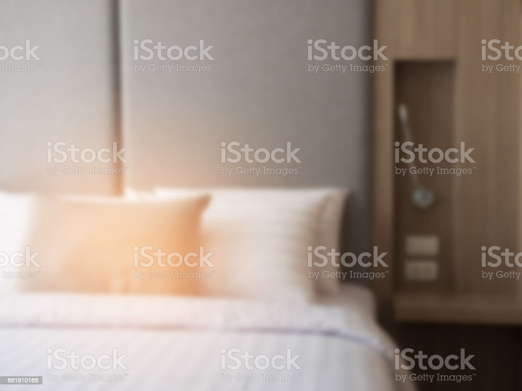 Interior of cozy bedroom in modern design.low lighting and Lens flair in sunlight. color effect and blur background. stock photo