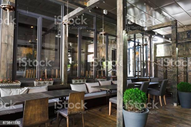 Interior of cozy restaurant loft style picture id873841530?b=1&k=6&m=873841530&s=612x612&h=m6v6 r4paubomgcqgabfeaagon xlawhxpvzmw c6p0=