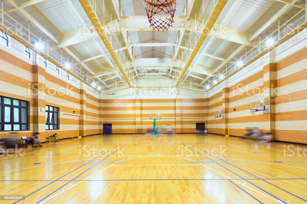 interior of empty basketball court stock photo
