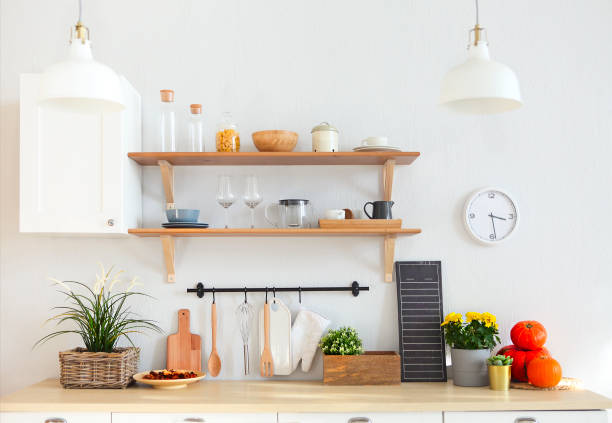 Interior of empty modern white kitchen with various objects stock photo