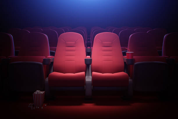 Interior of empty movie theater with red seats