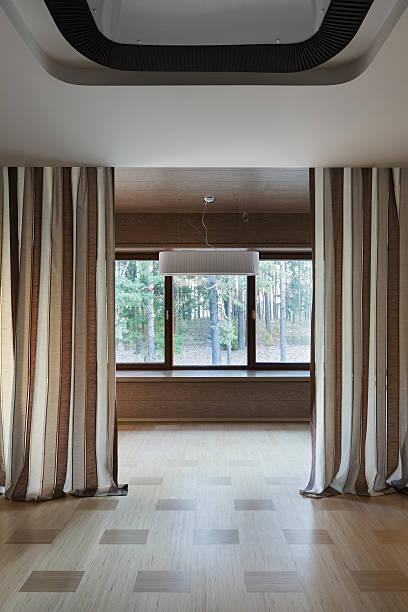 Interior of empty room with windows stock photo