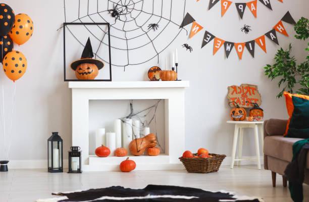 interior of house decorated for halloween pumpkins, webs and spiders - украшать стоковые фото и изображения