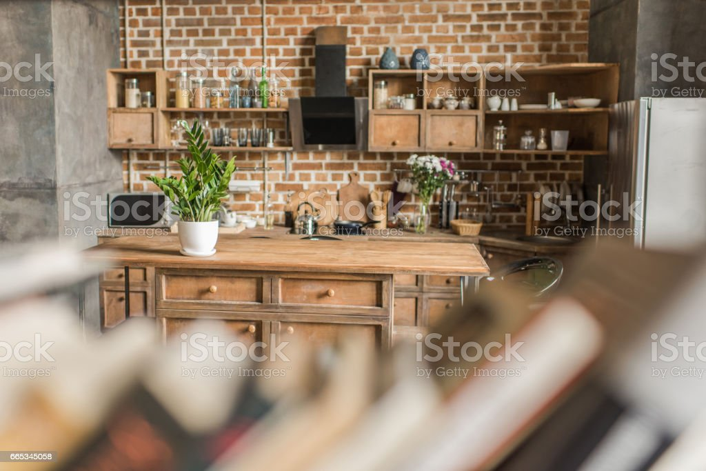 interior of kitchen with brick wall in loft style, focus on background