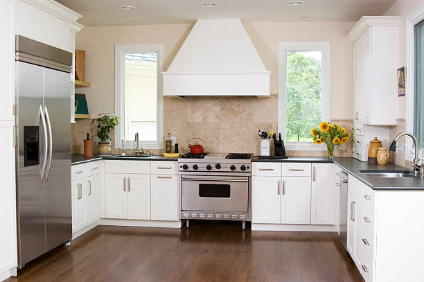 Interior of kitchen with white cabinetry and stainless steel stock photo