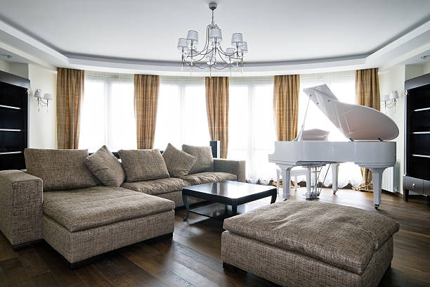 Interior of light living room with white piano stock photo