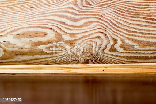 1124475954 istock photo Interior of log wooden house. Close-up wooden wall from round logs. Copy space. Place for custom text. 1164427457