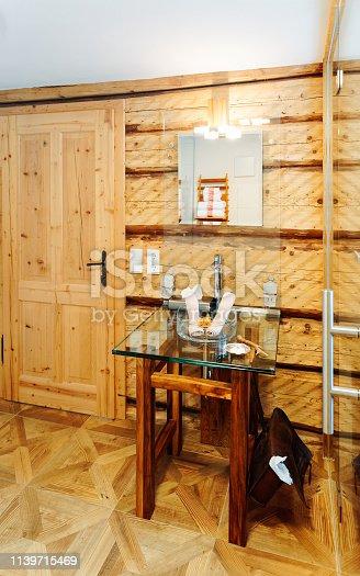 819534860istockphoto Interior of modern bathroom with wood design sink mirror 1139715469