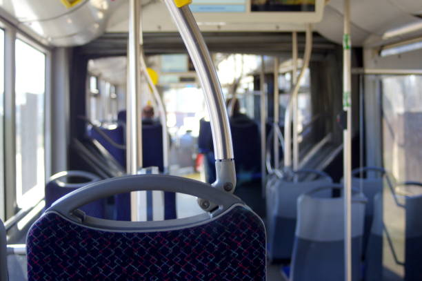 Interior of modern bus with passenger seats stock photo