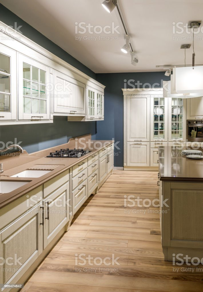 Interior of modern kitchen in white and blue tones royalty-free stock photo