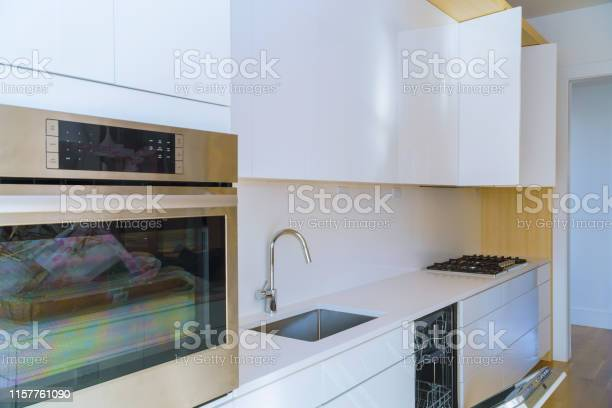 Interior Of Modern Kitchen With Appliances On Stove Top Marble Counter With Kitchen White Cabinets Stock Photo Download Image Now Istock
