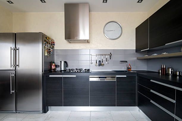 Interior of modern kitchen with black cabinets stock photo