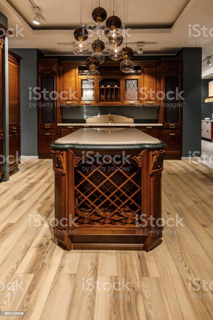 Interior of modern kitchen with chandelier and counter zbiór zdjęć royalty-free