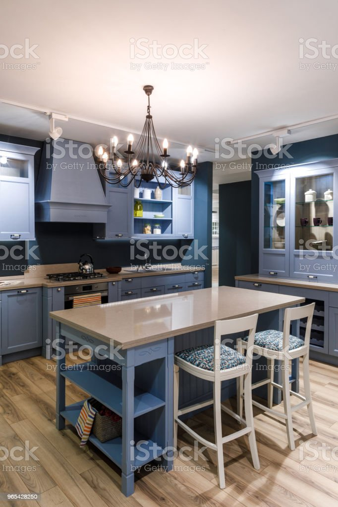 Interior of modern kitchen with chandelier over table royalty-free stock photo
