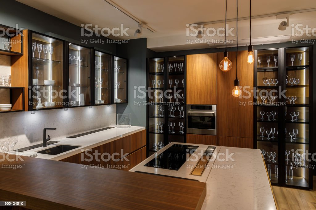Interior of modern kitchen with glass cabinets and decorative bulbs royalty-free stock photo