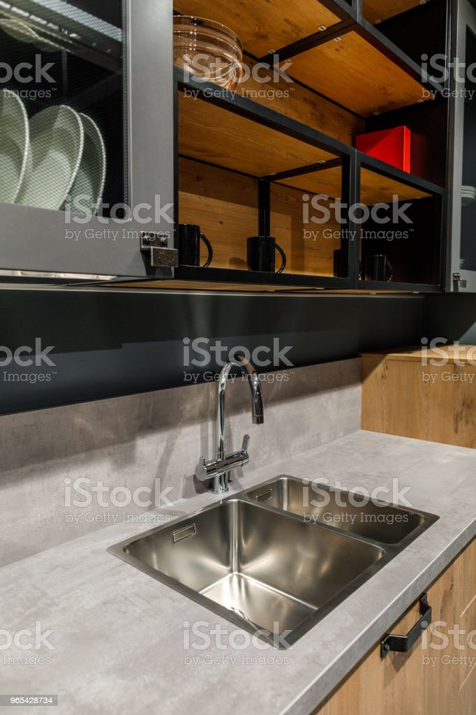 Interior of modern kitchen with metal sink zbiór zdjęć royalty-free